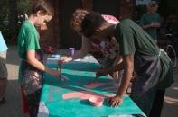 Painting mural panels at Painter Park.