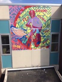 Mural over entrance on 34th St., in progress.